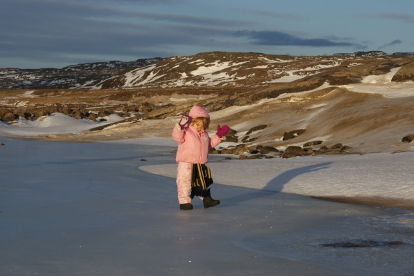 Exploring the frozen river, very carefully, on a weirdly warm November day when the snow half-melted.